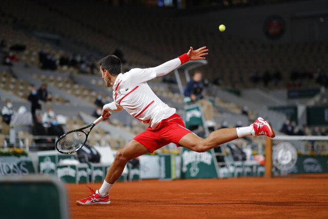 Serbia's Novak Djokovic plays a shot against Colombia's Daniel Elahi Galan in the third round match of the French Open tennis tournament at the Roland Garros stadium in Paris, France, Saturday, Oct. 3, 2020. (AP Photo/Christophe Ena)