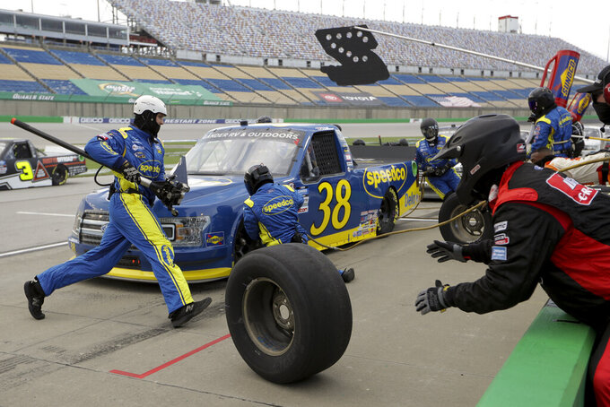Todd Gilliland (38) makes a Pitt stop during a NASCAR Truck Series race Saturday, July 11, 2020, in Sparta, Ky. (AP Photo/Mark Humphrey)