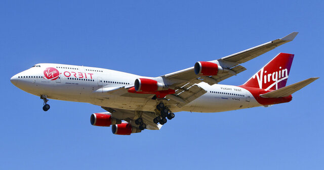 A Virgin Orbit Boeing 747-400 aircraft named Cosmic Girl prepares to land back at Mojave Air and Space Port in the desert north of Los Angeles Monday, May 25, 2020. Richard Branson's Virgin Orbit failed Monday in its first test launch of a new rocket carried aloft by the Boeing 747 and released over the Pacific Ocean off the coast of Southern California. (AP Photo/Matt Hartman)