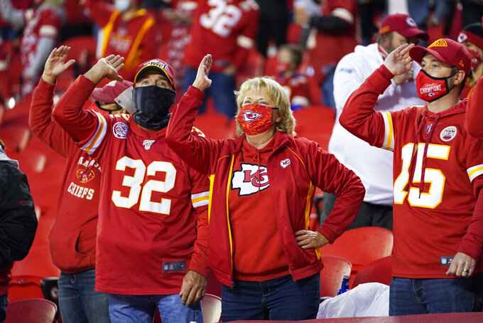 Kansas City Chiefs fans cheer in the first half of an NFL football game between the Chiefs and the Houston Texans Thursday, Sept. 10, 2020, in Kansas City, Mo. (AP Photo/Jeff Roberson)