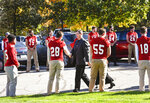 Jim Gagliardi, son of long time St. John's University football coach John Gagliardi, shakes hands with the football players at his fathers funeral Monday, Oct. 15, 2018, at the St. John's Abbey in Collegeville, Minn. Using unconventional methods at the small private university in Minnesota, Gagliardi won more football games than anybody who has ever coached in college. Gagliardi died Sunday, Oct. 7, 2018, at the age of 91. (Jason Wachter/St. Cloud Times via AP)
