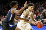 Cincinnati guard Jarron Cumberland (34) drives to the basket as Tulsa guard Brandon Rachal (0) defends during the first half of an NCAA college basketball game Wednesday, Jan. 8, 2020, in Cincinnati. (Kareem Elagazzar/The Cincinnati Enquirer via AP)