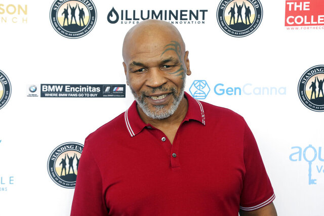 FILE - In this Aug. 2, 2019, file photo, Mike Tyson attends a celebrity golf tournament in Dana Point, Calif. Tyson is coming back to boxing at age 54. The former heavyweight champion will meet four-division champion Roy Jones Jr. in an eight-round exhibition match on Sept. 12. (Photo by Willy Sanjuan/Invision/AP, File)