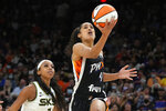 Phoenix Mercury guard Skylar Diggins-Smith (4) drives past Chicago Sky guard Lexie Brown during the first half of Game 2 of basketball's WNBA Finals, Wednesday, Oct. 13, 2021, in Phoenix. (AP Photo/Rick Scuteri)