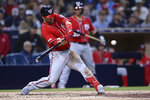 Washington Nationals' Brian Dozier hits a two-run home run during the fourth inning of the team's baseball game against the San Diego Padres on Saturday, June 8, 2019, in San Diego. (AP Photo/Orlando Ramirez)