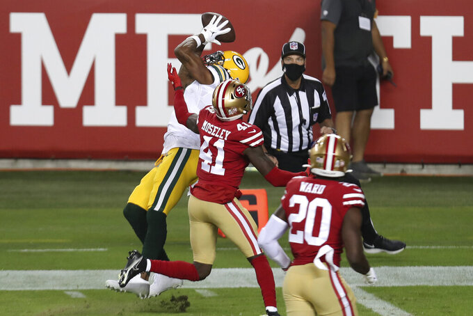 Green Bay Packers wide receiver Davante Adams, left, catches a touchdown next to San Francisco 49ers cornerback Emmanuel Moseley (41) during the first half of an NFL football game in Santa Clara, Calif., Thursday, Nov. 5, 2020. (AP Photo/Jed Jacobsohn)