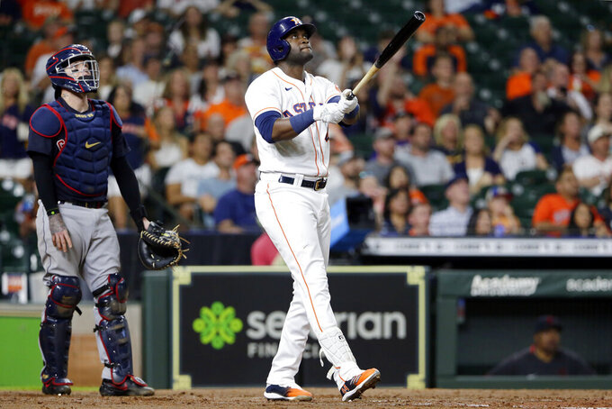 Cleveland Indians catcher Roberto Perez, left, and Houston Astros designated hitter Yordan Alvarez, right, watch Alvarez's the two run homer during the fifth inning of a baseball game Monday, July 19, 2021, in Houston. (AP Photo/Michael Wyke)