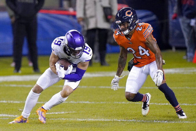 Minnesota Vikings wide receiver Adam Thielen (19) catches a pass as Chicago Bears cornerback Buster Skrine (24) defends during the first half of an NFL football game Monday, Nov. 16, 2020, in Chicago. (AP Photo/Nam Y. Huh)