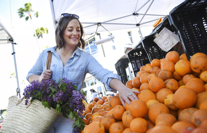 This April 10, 2019 photo shows Gaby Dalkin shopping for oranges at Santa Monica Downtown Farmers Market in Santa Monica, Calif. Dalkin, the chef behind the popular Website and social media accounts,