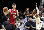 Miami Heat guard Tyler Herro (14) looks to pass as Cleveland Cavaliers guard Darius Garland defends during the first half of an NBA basketball game, Wednesday, Nov. 20, 2019, in Miami. (AP Photo/Lynne Sladky)