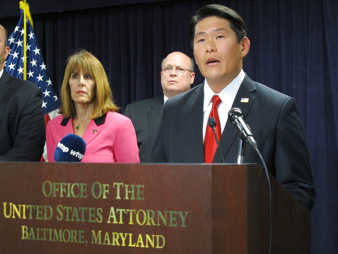 Maryland U.S. Attorney Robert Hur announces an 11-count indictment against former Baltimore Mayor Catherine Pugh at a news conference in Baltimore on Wednesday, Nov. 20, 2019. The disgraced former mayor has been charged with fraud and tax evasion involving sales of her self-published children's books. (AP Photo/Brian Witte)