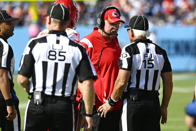 Kansas City Chiefs head coach Andy Reid argues with field judge Rick Patterson (15) in the second half of an NFL football game against the Tennessee Titans Sunday, Oct. 24, 2021, in Nashville, Tenn. (AP Photo/Mark Zaleski)