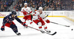 Carolina Hurricanes' Teuvo Teravainen, right, of Finland, carries the puck across the blue line as Columbus Blue Jackets' Cam Atkinson defends during the first period of an NHL hockey game Thursday, Jan. 16, 2020, in Columbus, Ohio. (AP Photo/Jay LaPrete)