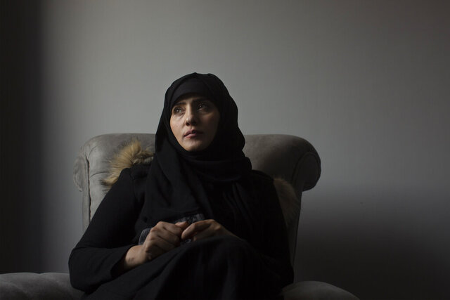 In this March 4, 2020 photo, Samera al-Huri, poses for a portrait in her home near Cairo, Egypt. As they grow more politically active, women are increasingly targeted by the Houthi rebels who rule northern Yemen. Hundreds of women have vanished into secret prisons where they are tortured and sometimes raped, former detainees and other activists say. The Houthis deny the claims, but six women who escaped to Egypt spoke to the Associated Press about their ordeals. (AP Photo/Maya Alleruzzo)