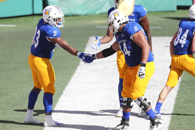 San Jose State linebacker Jordan Cobbs (44) congratulates running back Tyler Nevens (23) after Nevens made a touchdown against Hawaii in the first half of an NCAA college football game Saturday, Dec. 5, 2020, in Honolulu. (AP Photo/Marco Garcia)