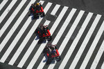 A group of people in go-karts cruise through the Shibuya crossing Thursday, June 13, 2019, in Tokyo. It's not just a crossing. Located just outside Shibuya Station, the scramble crossing is one of the top tourist attractions in Japan. It's so famous that there's an observation deck on the rooftop of a building built to watch the crossing. During rush hour, an estimated 1000 to 2500 people cross the intersection during each traffic light change. (AP Photo/Jae C. Hong)