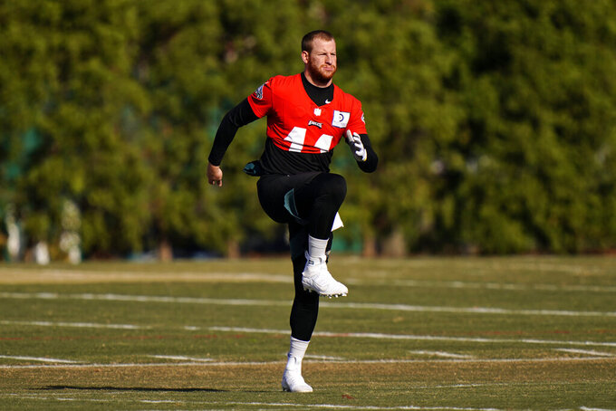Philadelphia Eagles' Carson Wentz stretches before practice at the NFL football team's training facility, Thursday, Nov. 19, 2020, in Philadelphia. (AP Photo/Matt Slocum, Pool)