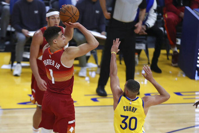 Denver Nuggets' Michael Porter Jr. shoots against Golden State Warriors' Stephen Curry during the first half of an NBA basketball game in San Francisco, Friday, April 23, 2021. (AP Photo/Jed Jacobsohn)