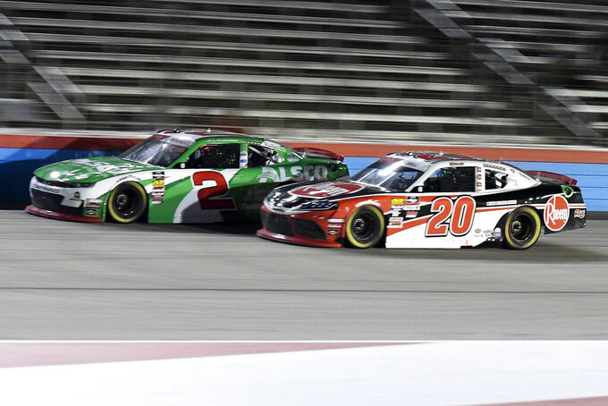 Tyler Reddick (2) and Christopher Bell (20) come out of Turn 4 during the NASCAR Xfinity Series auto race at Texas Motor Speedway in Fort Worth, Texas, Saturday, Nov. 2, 2019. (AP Photo/Randy Holt)