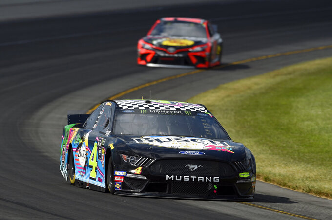 Kevin Harvick drives through Turn 3 during a NASCAR Cup Series auto race, Sunday, July 28, 2019, in Long Pond, Pa. (AP Photo/Derik Hamilton)