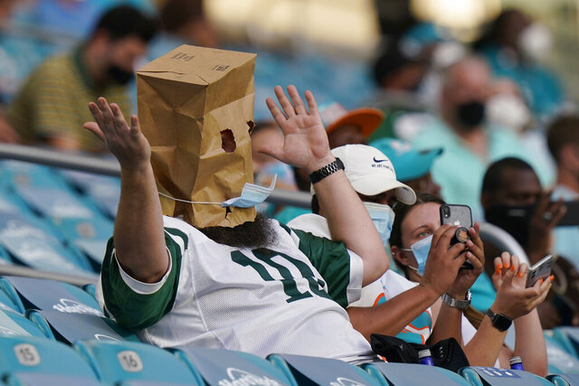 A New York Jets fans reacts to the team performance during the second half of an NFL football game against the Miami Dolphins, Sunday, Oct. 18, 2020, in Miami Gardens, Fla. (AP Photo/Lynne Sladky)