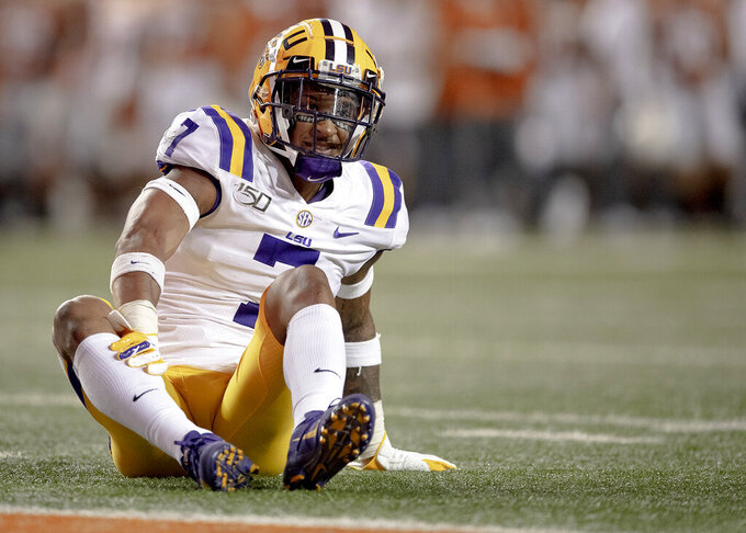 LSU safety Grant Delpit (7) stops play with an injury against Texas during an NCAA football game on Saturday, Sept. 7, 2019, in Austin, Texas. (Nick Wagner/American-Statesman via AP)