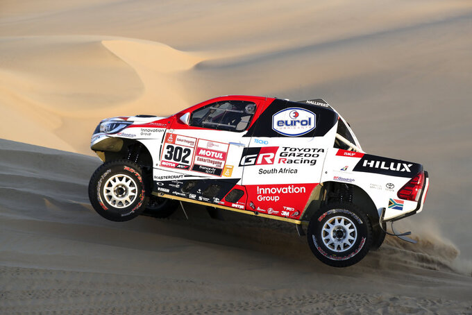 Driver Giniel De Villiers, of South Africa, and co-driver Dirk Von Zitzewitz, of Germany, race their Toyota during the second stage of the Dakar Rally between Pisco and San Juan de Marcona, Peru, Tuesday, Jan. 8, 2019. (AP Photo/Ricardo Mazalan)