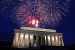FILE - In this July 4, 2019, file photo fireworks go off over the Lincoln Memorial in Washington. Government watchdogs say President Trump's 2019 Fourth of July gala in the nation's capital cost taxpayers more than $13 million, twice as much as previous celebrations. (AP Photo/Susan Walsh, File)