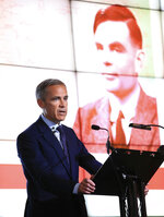 """Governor of the Bank of England, Mark Carney speaks, during the announcement that Second World War code-breaker Alan Turing has been selected to feature on the new 50 pound notes, at the Science and Industry Museum, in Manchester, England, Monday July 15, 2019.  The Bank of England has chosen codebreaker and computing pioneer Alan Turing as the face of the country's new 50 pound note. Governor Mark Carney said Monday that Turing was """"a giant on whose shoulders so many now stand."""" Turing's work cracking Nazi Germany's secret communications helped win World War II, but after the war he was prosecuted for homosexuality, and died in 1954 after eating an apple laced with cyanide. (Peter Byrne/PA via AP)"""