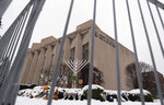 FILE--This file photo from Feb. 11, 2019 shows a temporary barrier around the Tree of Life Synagogue in Pittsburgh where 11 people were killed and seven others injured during an attack on in October of 2018. The synagogue is inviting young people worldwide to submit artwork in an art project called