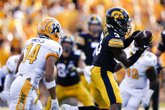 Iowa wide receiver Tyrone Tracy Jr. (3) catches a pass ahead of Kent State cornerback Elvis Hines (14) during the second half of an NCAA college football game, Saturday, Sept. 18, 2021, in Iowa City, Iowa. Iowa won 30-7. (AP Photo/Charlie Neibergall)