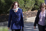 "FILE - In this Oct. 31, 2016, file photo, Sabrina Rubin Erdely, left, author of ""A Rape on Campus,"" a now retracted Rolling Stone article detailing an alleged rape at the University of Virginia, walks to the federal courthouse in Charlottesville, Va., with an attorney. Charlottesville, a Virginia city once marred by tiki torches, Nazi chants and deadly violence, savored a moment of bliss Tuesday, April 9. 2019, as it welcomed home national men's college basketball champion University of Virginia. (Ryan M. Kelly/The Daily Progress via AP, File)"