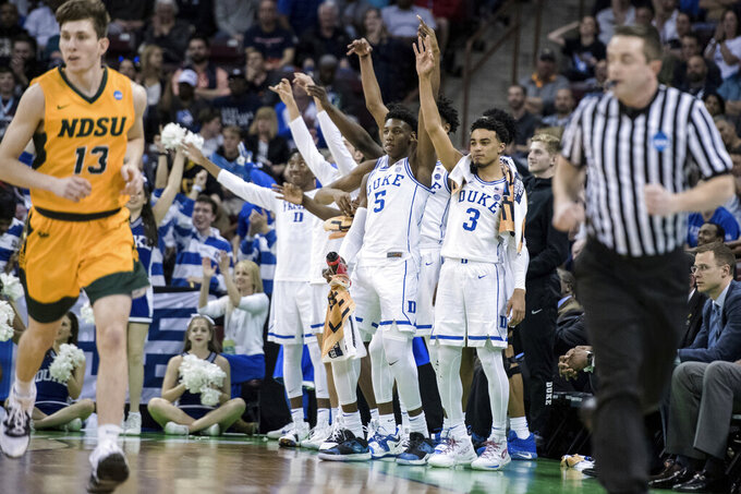 Duke guard Tre Jones (3) and RJ Barrett (5) react to a score against North Dakota State during the second half of a first-round game in the NCAA men's college basketball tournament Friday, March 22, 2019, in Columbia, S.C. Duke defeated North Dakota State 85-62. (AP Photo/Sean Rayford)