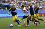 Germany's Lina Magull, second from left, challenges for the ball with Sweden's Nilla Fischer, left, during the of the Women's World Cup quarterfinal soccer match between Germany and Sweden at Roazhon Park in Rennes, France, Saturday, June 29, 2019. (AP Photo/David Vincent)