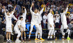 Arizona State players on the bench celebrate after a 3-point shot against Oregon during the first half of an NCAA college basketball game Saturday, Jan. 19, 2019, in Tempe, Ariz. (AP Photo/Darryl Webb)