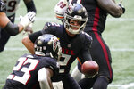 Atlanta Falcons quarterback Matt Ryan (2) hands the ball off to Atlanta Falcons running back Brian Hill (23) against the Chicago Bears during the second half of an NFL football game, Sunday, Sept. 27, 2020, in Atlanta. (AP Photo/Brynn Anderson)