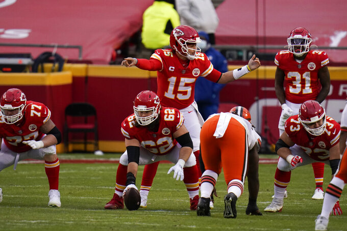 Kansas City Chiefs quarterback Patrick Mahomes (15) signals teammates at the line of scrimmage during the second half of an NFL divisional round football game against the Cleveland Browns, Sunday, Jan. 17, 2021, in Kansas City. (AP Photo/Jeff Roberson)