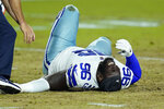 Dallas Cowboys defensive tackle Neville Gallimore (96) lies injured on the turf during the first half of an NFL preseason football game against the Arizona Cardinals, Friday, Aug. 13, 2021, in Glendale, Ariz. (AP Photo/Ross D. Franklin)