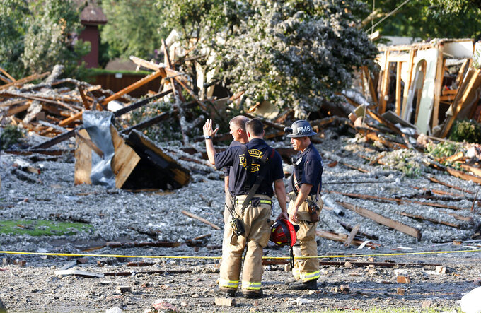 Plano Fire Department personnel work the scene after a home exploded at about 4:45 p.m. in the 4400 block of Cleveland Drive in Plano, Texas, Monday, July 19, 2021. (Stewart F. House/The Dallas Morning News via AP)