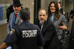 Harvey Weinstein leaves court in his rape trial, in New York, Wednesday, Jan. 22, 2020. Two of his attorneys, Arthur Aidala, and Donna Rotunno, are background left and background right. (AP Photo/Richard Drew)