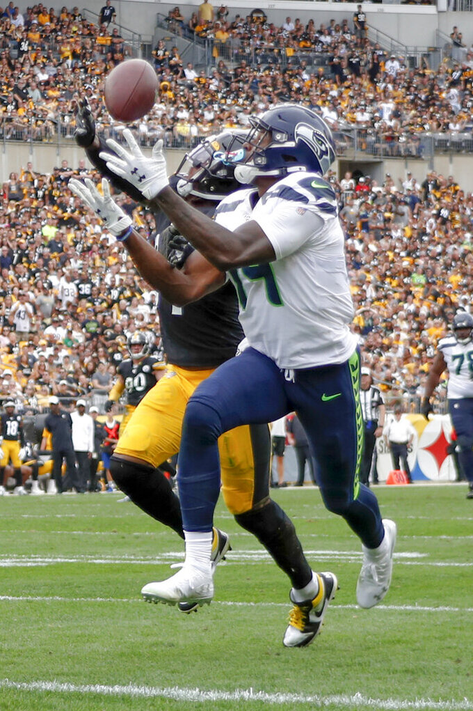 Seattle Seahawks wide receiver D.K. Metcalf (14) makes a catch past Pittsburgh Steelers strong safety Terrell Edmunds, left, for a touchdown in the second half of an NFL football game Sunday, Sept. 15, 2019, in Pittsburgh. The play was reviewed and let stand as a touchdown. (AP Photo/Don Wright)
