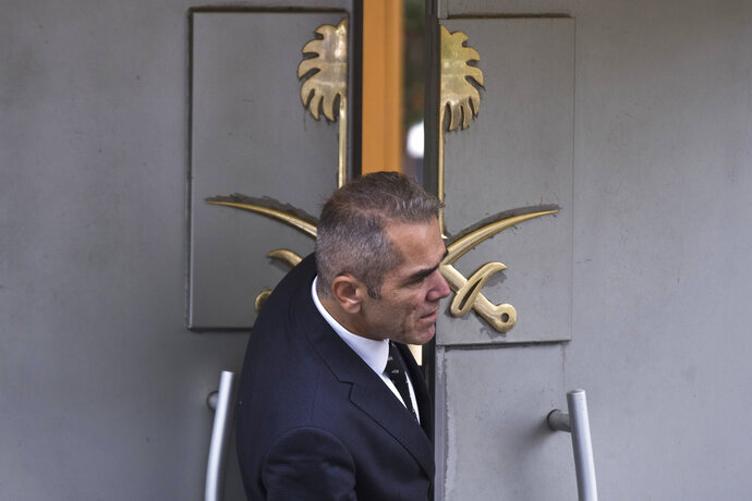 A security guard looks out of the entrance of Saudi Arabia's consulate in Istanbul, Friday, Oct. 12, 2018. A senior Turkish official says Turkey and Saudi Arabia will form a