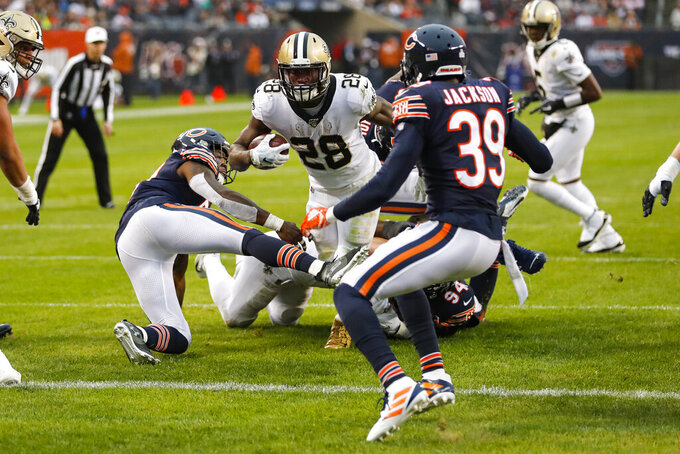 New Orleans Saints running back Latavius Murray (28) dives in for a touchdown between Chicago Bears inside linebacker Danny Trevathan (59) and free safety Eddie Jackson (39) during the second half of an NFL football game in Chicago, Sunday, Oct. 20, 2019. (AP Photo/Charles Rex Arbogast)
