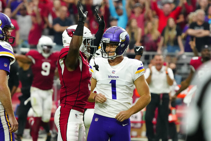 Arizona Cardinals strong safety Budda Baker celebrates after Minnesota Vikings kicker Greg Joseph (1) reacts to missing a game-winning field goal attempt during the second half of an NFL football game, Sunday, Sept. 19, 2021, in Glendale, Ariz. The Cardinals won 34-33. (AP Photo/Rick Scuteri)