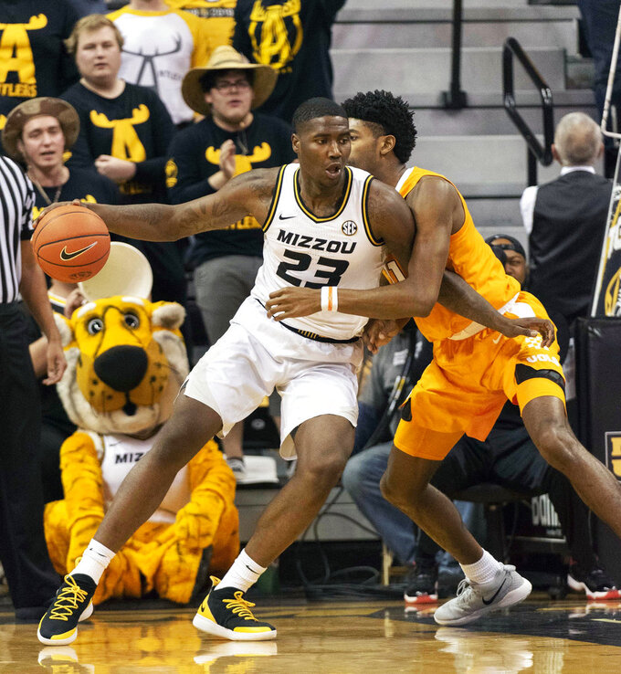 Missouri's Jeremiah Tilmon, left, pushes against Tennessee's Kyle Alexander, right, as he moves toward the basket during the first half of an NCAA college basketball game Tuesday, Jan. 8, 2019, in Columbia, Mo. (AP Photo/L.G. Patterson)