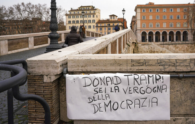 "A sign is exposed on Sisto bridge in Rome reading in Italian: ""Donald Tramp you are the shame of democracy."", Thursday,  Jan. 7, 2021. Italians on the street in Rome Thursday expressed shock and horror at the events on Capitol Hill in Washington Wednesday evening and cast blame on lame duck President Donald Trump. (AP Photo/Andrew Medichini)"