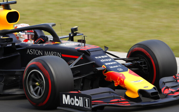 Red Bull driver Max Verstappen of the Netherland's steers his car during the third practice session of the Hungarian Formula One Grand Prix at the Hungaroring racetrack in Mogyorod, northeast of Budapest, Hungary, Saturday, Aug. 3, 2019. The Hungarian Formula One Grand Prix takes place on Sunday. (AP Photo/Laszlo Balogh)
