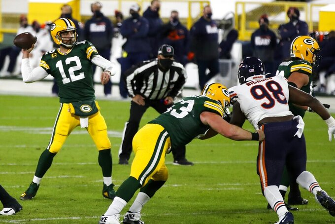 Green Bay Packers' Aaron Rodgers throws during the first half of an NFL football game against the Chicago Bears Sunday, Nov. 29, 2020, in Green Bay, Wis. (AP Photo/Matt Ludtke)