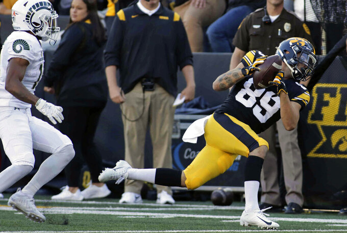 Iowa wide receiver Nico Ragaini (89) makes a catch on a pass during the second half of an NCAA college football game against Colorado State, Saturday, Sept. 25, 2021, in Iowa City, Iowa. (AP Photo/Ron Johnson)