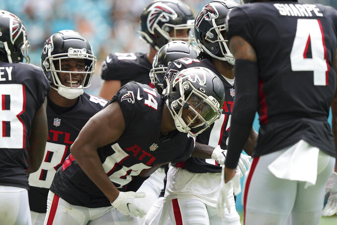 Atlanta Falcons wide receiver Russell Gage (14) celebrates after scoring a touchdown during the second half of an NFL football game against the Miami Dolphins, Sunday, Oct. 24, 2021, in Miami Gardens, Fla. (AP Photo/Hans Deryk)